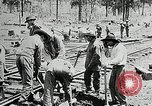 Image of railway construction and paving of muddy roads United States USA, 1927, second 29 stock footage video 65675030520
