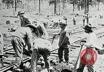 Image of railway construction and paving of muddy roads United States USA, 1927, second 30 stock footage video 65675030520