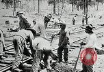 Image of railway construction and paving of muddy roads United States USA, 1927, second 32 stock footage video 65675030520