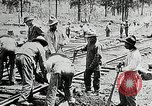 Image of railway construction and paving of muddy roads United States USA, 1927, second 33 stock footage video 65675030520