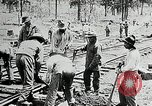 Image of railway construction and paving of muddy roads United States USA, 1927, second 34 stock footage video 65675030520