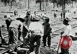 Image of railway construction and paving of muddy roads United States USA, 1927, second 36 stock footage video 65675030520