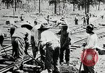 Image of railway construction and paving of muddy roads United States USA, 1927, second 37 stock footage video 65675030520