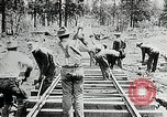Image of railway construction and paving of muddy roads United States USA, 1927, second 38 stock footage video 65675030520