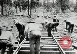 Image of railway construction and paving of muddy roads United States USA, 1927, second 39 stock footage video 65675030520