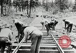 Image of railway construction and paving of muddy roads United States USA, 1927, second 40 stock footage video 65675030520