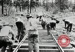 Image of railway construction and paving of muddy roads United States USA, 1927, second 41 stock footage video 65675030520