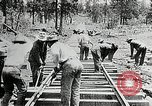 Image of railway construction and paving of muddy roads United States USA, 1927, second 42 stock footage video 65675030520