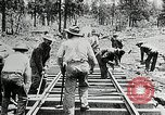 Image of railway construction and paving of muddy roads United States USA, 1927, second 43 stock footage video 65675030520