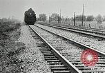 Image of railway construction and paving of muddy roads United States USA, 1927, second 54 stock footage video 65675030520