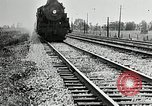 Image of railway construction and paving of muddy roads United States USA, 1927, second 56 stock footage video 65675030520