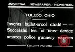 Image of bullet proof cloth test Toledo Ohio USA, 1932, second 2 stock footage video 65675030579