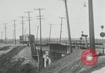 Image of automobile delivery by trains Chicago Illinois USA, 1932, second 34 stock footage video 65675030580