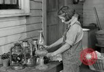 Image of Domestic chores without electricity Saint Clairsville Ohio USA, 1940, second 55 stock footage video 65675030602