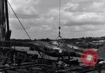 Image of P-38 plane assembly Australia, 1942, second 41 stock footage video 65675030611