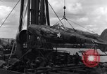 Image of P-38 plane assembly Australia, 1942, second 52 stock footage video 65675030611