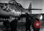 Image of ME-262 aircraft up on maintenance stands Germany, 1943, second 25 stock footage video 65675030710