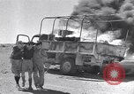 Image of Burning British vehicle North Africa, 1943, second 2 stock footage video 65675030883