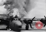 Image of C-87 in flames China, 1943, second 32 stock footage video 65675030937