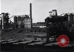 Image of Unloading ore at Ford plant Dearborn Michigan USA, 1929, second 7 stock footage video 65675030994