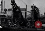 Image of Unloading ore at Ford plant Dearborn Michigan USA, 1929, second 28 stock footage video 65675030994