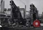Image of Unloading ore at Ford plant Dearborn Michigan USA, 1929, second 29 stock footage video 65675030994