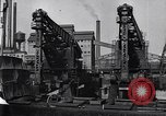 Image of Unloading ore at Ford plant Dearborn Michigan USA, 1929, second 32 stock footage video 65675030994