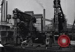 Image of Unloading ore at Ford plant Dearborn Michigan USA, 1929, second 34 stock footage video 65675030994