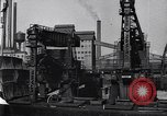 Image of Unloading ore at Ford plant Dearborn Michigan USA, 1929, second 35 stock footage video 65675030994