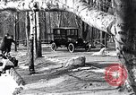 Image of Ford Model-T near icy pond United States USA, 1917, second 3 stock footage video 65675031043