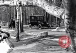 Image of Ford Model-T near icy pond United States USA, 1917, second 4 stock footage video 65675031043