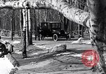 Image of Ford Model-T near icy pond United States USA, 1917, second 9 stock footage video 65675031043