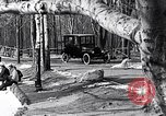 Image of Ford Model-T near icy pond United States USA, 1917, second 12 stock footage video 65675031043