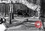 Image of Ford Model-T near icy pond United States USA, 1917, second 13 stock footage video 65675031043