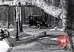 Image of Ford Model-T near icy pond United States USA, 1917, second 14 stock footage video 65675031043