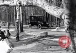 Image of Ford Model-T near icy pond United States USA, 1917, second 16 stock footage video 65675031043