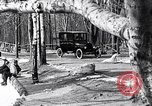 Image of Ford Model-T near icy pond United States USA, 1917, second 17 stock footage video 65675031043