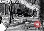 Image of Ford Model-T near icy pond United States USA, 1917, second 19 stock footage video 65675031043