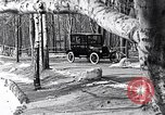 Image of Ford Model-T near icy pond United States USA, 1917, second 21 stock footage video 65675031043
