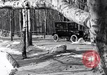 Image of Ford Model-T near icy pond United States USA, 1917, second 22 stock footage video 65675031043