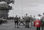 Image of USS Forrestal fire cleanup Gulf of Tonkin Vietnam, 1967, second 44 stock footage video 65675031062