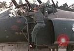 Image of F-4E aircraft and crew prepare and takeoff from Ramstein Air Base Ramstein Germany, 1969, second 5 stock footage video 65675031085