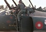 Image of F-4E aircraft and crew prepare and takeoff from Ramstein Air Base Ramstein Germany, 1969, second 6 stock footage video 65675031085