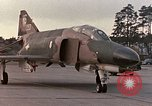 Image of F-4E aircraft and crew prepare and takeoff from Ramstein Air Base Ramstein Germany, 1969, second 15 stock footage video 65675031085