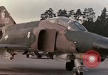 Image of F-4E aircraft and crew prepare and takeoff from Ramstein Air Base Ramstein Germany, 1969, second 17 stock footage video 65675031085