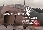 Image of F-4E aircraft and crew prepare and takeoff from Ramstein Air Base Ramstein Germany, 1969, second 19 stock footage video 65675031085
