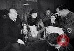 Image of German civilians donating Germany, 1942, second 62 stock footage video 65675031295