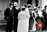 Image of Well dressed African-Americans waiting at a school near a Tennessee Emergency relief camp Tennessee USA, 1936, second 1 stock footage video 65675031562