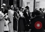 Image of Well dressed African-Americans waiting at a school near a Tennessee Emergency relief camp Tennessee USA, 1936, second 5 stock footage video 65675031562