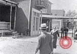 Image of Well dressed African-Americans waiting at a school near a Tennessee Emergency relief camp Tennessee USA, 1936, second 12 stock footage video 65675031562